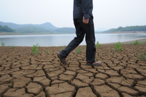 A man walks along the dried-up the banks