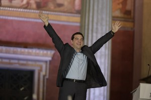"Syriza leader Alexis Tsipras greets supporters following victory in the election in Athens on January 25, 2015.  Greek Prime Minister Antonis Samaras  said the nation ""had spoken"" in handing victory to the anti-austerity Syriza party, and said he hoped the new government would not endanger the country's EU and euro membership.  ""I hand over a country that is part of the EU and the euro. For the good of this country, I hope the next government will maintain what has been achieved,"" Samaras said in a brief address to reporters.  AFP PHOTO / LOUISA GOULIAMAKI        (Photo credit should read LOUISA GOULIAMAKI/AFP/Getty Images)"